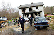 Worcester County Fire Marshal Jeffrey McMahon and Chief Deputy Fire Marshall Matthew Owens walk away from the scene of a fire that occurred early Friday morning in Showell. Two children were killed in the blaze.