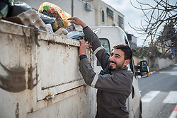 2 March 2020, Hebron: Young Palestinian man Kazm works to empty garbage cans in the area of Tel Rumeida, in Hebron, West Bank.