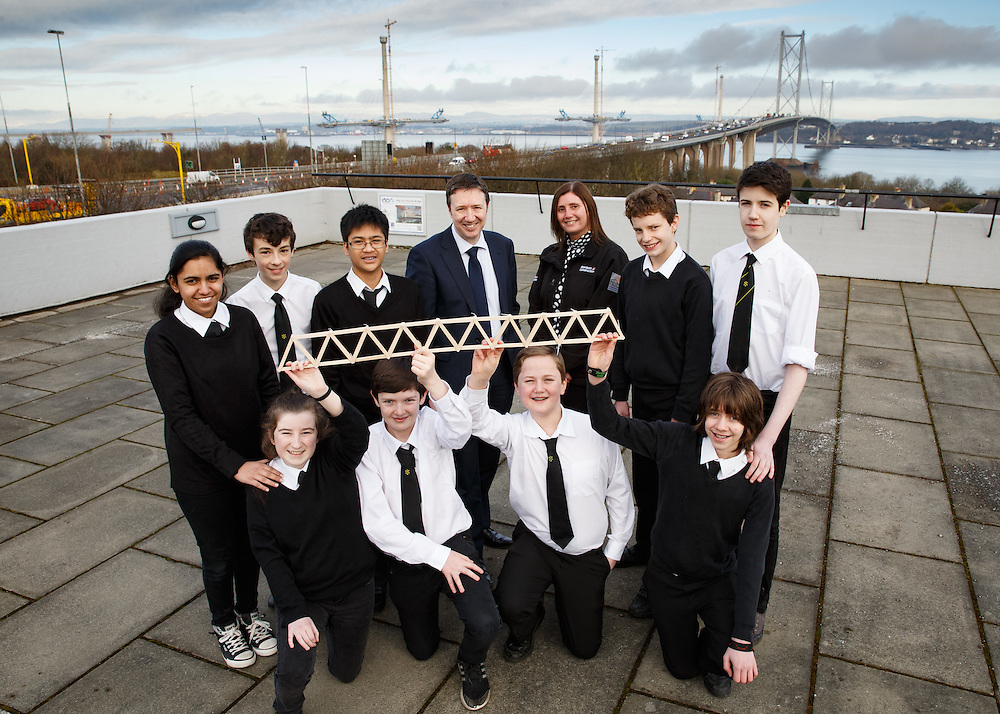 """FREE PICTURES- A new YESC project sponsored by Morrison Construction titled """"Go Forth!"""". The project is challenging science clubs across Scotland to create a suspension bridge, inspired by the Queensferry Crossing, which will then be tested at the YESC regional and national celebrations. <br /> SCDI's Young Engineers and Science Clubs (YESC) Scotland has created an exciting new engineering project inspired by the Queensferry Crossing – the Go Forth! Challenge. Over 300 schools across Scotland, from Shetland to Dumfries, are receiving free kits containing all they need to design and build a suspension or cable-stayed bridge. <br /> Pupils from Trinity Academy , Edinburgh with the beginnings of their bridge. Front (kneeling) L to R : Corinna O'Malley Hamilton, Fraser Allan, Angus Wilson and Lewis Campbell.  Back L to R : Shumaila Anwar, Sean Mclean, Francis Melendres, <br /> David Wilson, Director, Morrison Construction<br /> Alice Harley, Skills Coordinator, Morrison Construction,<br /> Calum Orr and Max Fleming.<br />  Picture Robert Perry 26th Feb 2016<br /> <br /> Please credit photo to Robert Perry<br /> <br /> Image is free to use in connection with the promotion of the above company or organisation. 'Permissions for ALL other uses need to be sought and payment make be required.<br /> <br /> <br /> Note to Editors:  This image is free to be used editorially in the promotion of the above company or organisation.  Without prejudice ALL other licences without prior consent will be deemed a breach of copyright under the 1988. Copyright Design and Patents Act  and will be subject to payment or legal action, where appropriate.<br /> www.robertperry.co.uk<br /> NB -This image is not to be distributed without the prior consent of the copyright holder.<br /> in using this image you agree to abide by terms and conditions as stated in this caption.<br /> All monies payable to Robert Perry<br /> <br /> (PLEASE DO NOT REMOVE THIS CAPTION)<br /> This image is intended for Edi"""
