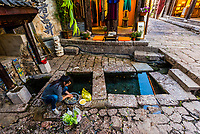 Three pit well. Three pools are made at the mouth of the water source. The three wells (upper to lower) are for drinking water, washing vegetables and washing clothes. The Old Town (Dayan) of Lijiang, Yunnan Province, China. The Old Town is a UNESCO World Heritage Site.