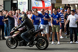 Leicester City fans take over O'Neils Irish bar in Seville and cheer on a motorcyclist before the game - Rogan Thomson/JMP - 22/02/2017 - FOOTBALL - Estadio Ramon Sanchez Pizjuan - Seville, Spain - Sevilla FC v Leicester City - UEFA Champions League Round of 16, 1st Leg.