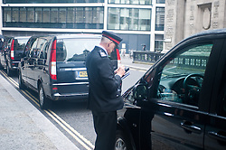 """Saudi Prince Alwaleed bin Talal Court Case.<br /> A police officer fines Prince Al-Waleed's van's which are parked on double line's outside the High Court.<br /> Consultant Daad Sharab claims Saudi Prince Al-Waleed Bin Talal Bin Abdul-Aziz Al-Saud owes her around £6.5 million commission for the part she played in a 2005 Airbus deal. Prince Al-Waleed disputes her claim and denies that any agreement was made for a """"specific commission"""",<br /> London, United Kingdom<br /> Tuesday, 2nd July 2013<br /> Picture by Piero Cruciatti / i-Images"""