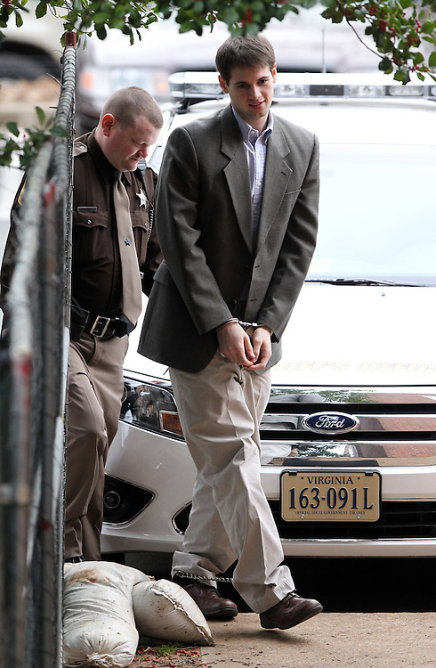 CHARLOTTESVILLE, VA - FEBRUARY 14: George Huguely is escorted to court Tuesday morning as his trial in the death of former girlfriend Yeardley Love continues. Huguely was charged in the May 2010 death of his girlfriend Yeardley Love. She was a member of the Virginia women's lacrosse team. Huguely pleaded not guilty to first-degree murder. (Credit Image: © Andrew Shurtleff