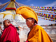 07 MARCH 2017 - KATHMANDU, NEPAL: A Buddhist lama walks around the stupa during the consecration ceremony at Boudhanath Stupa. Boudhanath Stupa, the most important Buddhist site in Nepal and a popular tourist attraction, was consecrated Tuesday in a ceremony attended by thousands of Buddhist monks and Buddhist people from Nepal and Tibet. The stupa was badly damaged in the 2015 earthquake that devastated Nepal. The stupa, which reopened in November 2016, was repaired in about 18 months. The repair was financed by private donations raised by international Buddhist organizations.     PHOTO BY JACK KURTZ