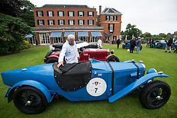 © Licensed to London News Pictures. 13/07/2015. Epsom, UK. Classic car enthusiast examines a 1929 Riley Sports  on display before the race. The start of The Royal Automobile Club 1000 Mile Trial 2015 at Woodcote Park in Epsom, Surrey. The event, which starts and finishes at Woodcote Park, takes a fleet of over 40 classic cars from around the world, through a 1000 mile trial around the UK.  Photo credit: Ben Cawthra/LNP