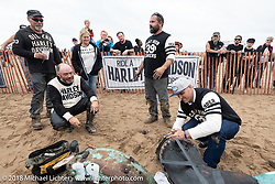 Kevin Baas gets help from friends on a needed repair at the Bradford Beach Brawl, a TROG style beach racing event, during the Harley-Davidson 115th Anniversary Celebration event. Milwaukee, WI. USA. Saturday September 1, 2018. Photography ©2018 Michael Lichter.