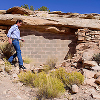 Sen. Martin Heinrich hikes down to see the sealed-off entrance to an abandoned uranium mine during a tour in Red Valley Friday.