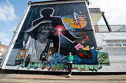 A 9 metre George Michael mural painted in Kingsbury by artist Dawn Mellor, North West London, Great Britain <br /> Unveiled 17th September 2020    <br /> <br /> Dawn Mellor - artist <br /> <br /> A large-scale mural that celebrates the life of local hero George Michael who was a 1st year pupil at Kingsbury High School in 1974. <br /> Commissioned as part of the Brent supported by the Brent Borough of Culture 2020 fund. <br /> <br /> Photograph by Elliott Franks