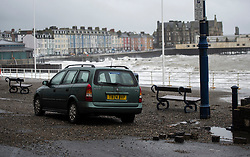© Licensed to London News Pictures. 27/01/2016. Aberystwyth, UK.  Debris washed on shore and damage caused to a wall by waves at Aberystwyth in wales at high tide. The tail end of storm Jonas continues to hit the UK, bringing torrential rain and galesPhoto credit: Keith Morris/LNP