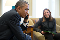 President Barack Obama talks on the phone with a person who has gained health care coverage through the Affordable Care Act, in the Oval Office, Feb. 17, 2015. Health and Human Services Secretary Sylvia Mathews Burwell is seated at right. (Official White House Photo by Pete Souza)<br /> <br /> This official White House photograph is being made available only for publication by news organizations and/or for personal use printing by the subject(s) of the photograph. The photograph may not be manipulated in any way and may not be used in commercial or political materials, advertisements, emails, products, promotions that in any way suggests approval or endorsement of the President, the First Family, or the White House.