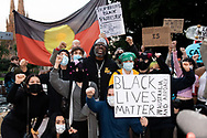 Protesters shout slogans and hold up signs in Hyde Park during a 'Black Lives Matter' rally on 02 June, 2020 in Sydney, Australia. This event was organised to rally against aboriginal deaths in custody in Australia as well as in unity with protests across the United States following the killing of an unarmed black man George Floyd at the hands of a police officer in Minneapolis, Minnesota. (Photo by Steven Markham/ Speed Media)