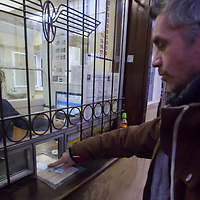 Passenger buys tickets from a young girl sitting at the cashier window at the Szechenyi hegy station of Children's Railway in Budapest, Hungary on November 16, 2014. ATTILA VOLGYI