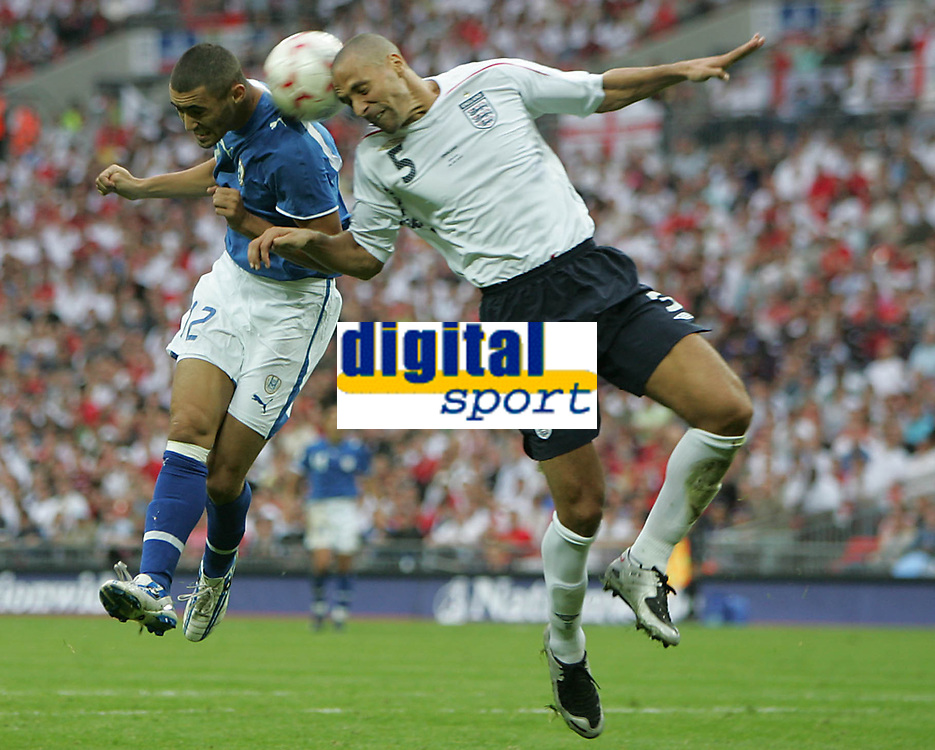 Photo: Lee Earle.<br /> England v Israel. UEFA European Championships Qualifying. 08/09/2007.England's Rio Ferdinand (R) clashes with Omer Golan.