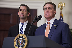 August 2, 2017 - Washington, District of Columbia, U.S. - Senator DAVID PERDUE (Republican of Georgia), right, makes an announcement on the introduction of the Reforming American Immigration for a Strong Economy (RAISE) Act in the Roosevelt Room at the White House. The act aims to overhaul U.S. immigration by moving towards a ''merit-based'' system.  Pictured at left is US Senator Tom Cotton (Republican of Arkansas). (Credit Image: © Zach Gibson/CNP via ZUMA Wire)