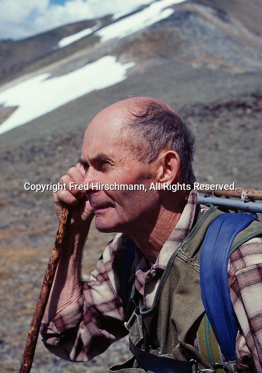 Dick Proenneke hiking on ridge leading to Falls Mountain, Lake Clark National Park, Alaska.