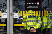 As environmental activists protest about Climate Change, police officers guard the terminal building during the occupation of City Airport (London's Business Travel hub) in east London, the fourth day of a two-week prolonged worldwide protest by members of Extinction Rebellion, on 10th October 2019, in London, England.