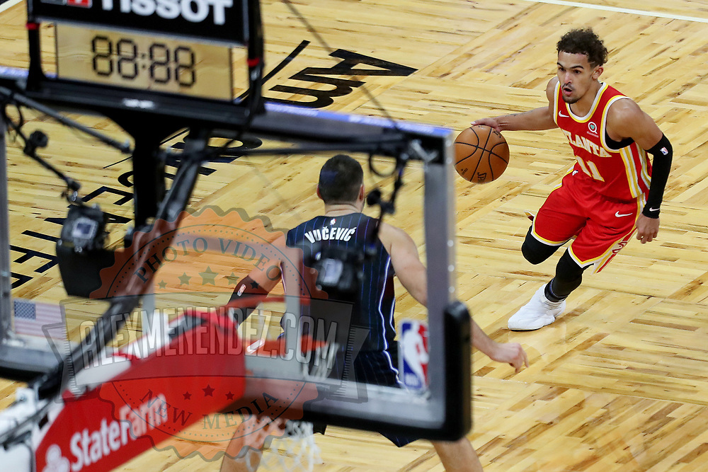 ORLANDO, FL - MARCH 03: Trae Young #11 of the Atlanta Hawks drives to the net as Nikola Vucevic #9 of the Orlando Magic defends at Amway Center on March 3, 2021 in Orlando, Florida. NOTE TO USER: User expressly acknowledges and agrees that, by downloading and or using this photograph, User is consenting to the terms and conditions of the Getty Images License Agreement. (Photo by Alex Menendez/Getty Images)*** Local Caption *** Trae Young;  Nikola Vucevic
