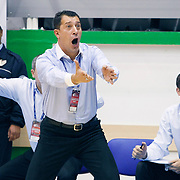 Anadolu Efes's coach Ufuk SARICA (C) during their Turkey Cup Qualifying basketball second match Anadolu Efes between Pinar Karsiyaka at Aliaga Arena in Izmir, Turkey, Monday, October 10, 2011. Photo by TURKPIX