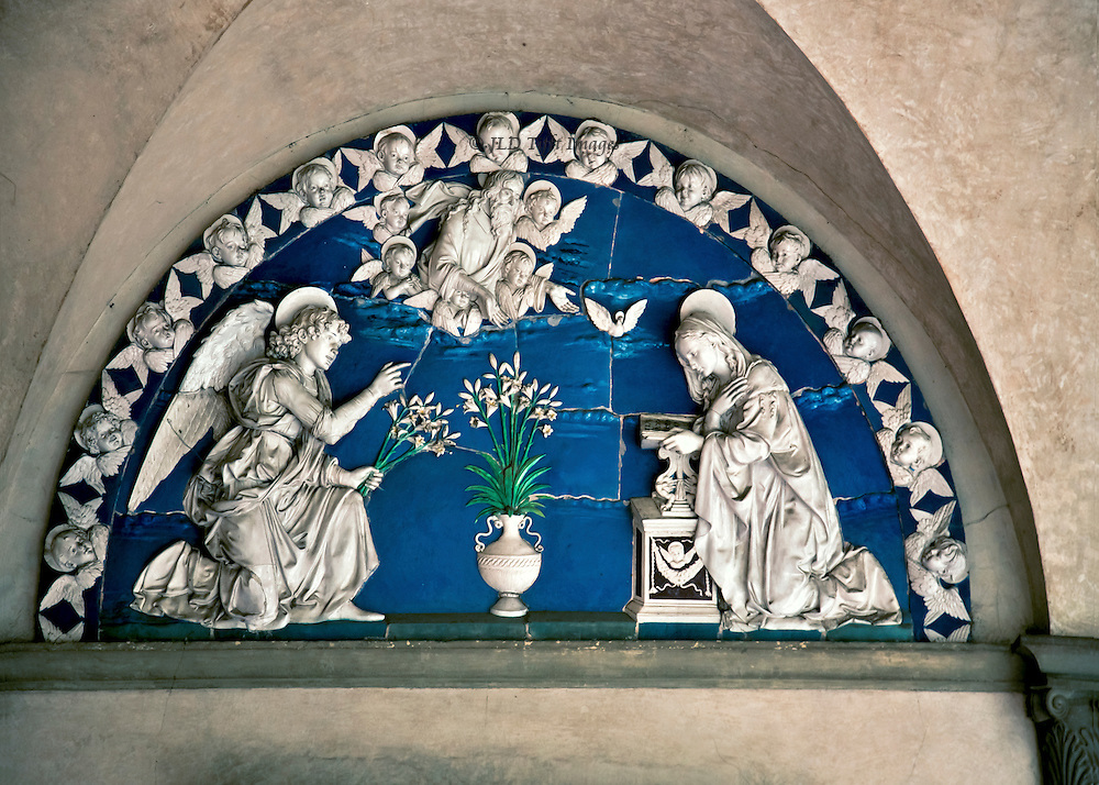 """Annunciation by Luca della Robbia is set into the arched vault of the Ospedale degli Innocenti.  The """"Della Robbia blue"""" covers the background of the white figures of the angel and Mary."""