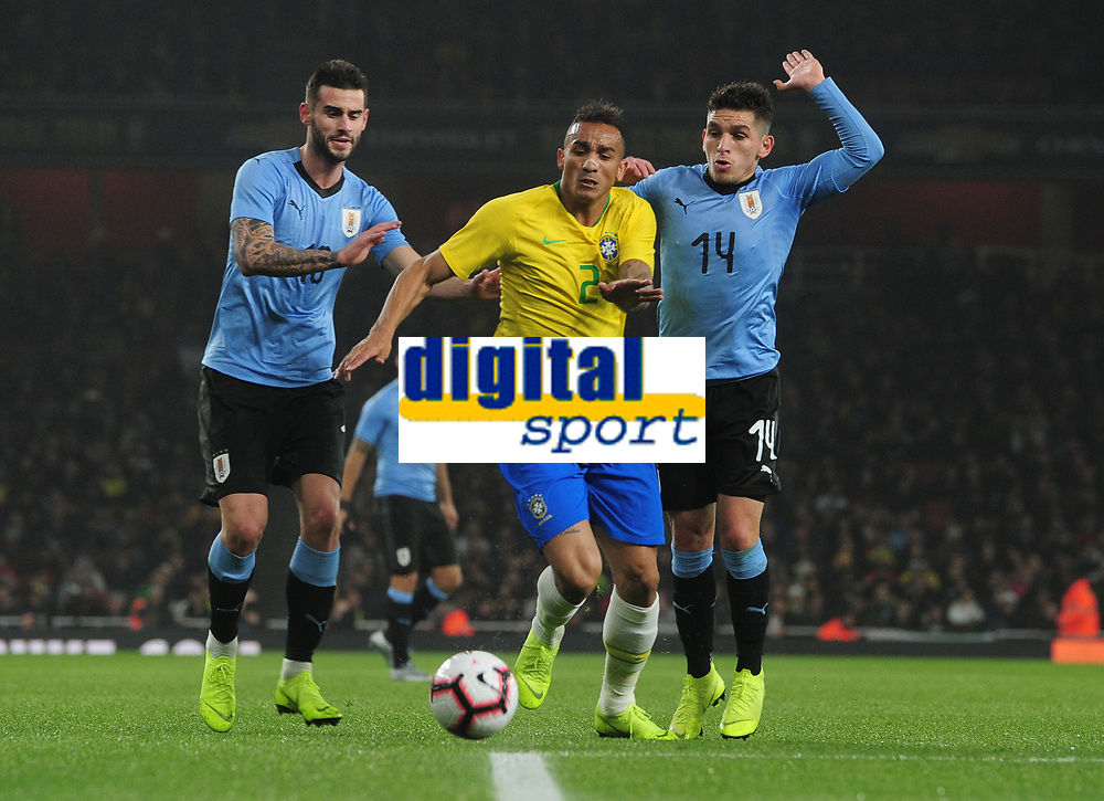 Football - 2018 / 2019 International Friendly - Brazil vs. Uruguay<br /> <br /> Danilo of Brazil nips in between Lucas Torreira and Gaston Pereiro of Uruguay, at The Emirates.<br /> <br /> COLORSPORT/ANDREW COWIE
