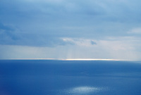 Sun rays and clouds over the Ligurian Sea off the coast of Italy