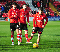 Lincoln City's Ellis Chapman,left, Scott Wharton, centre and Tom Pett during the pre-match warm-up<br /> <br /> Photographer Andrew Vaughan/CameraSport<br /> <br /> The EFL Sky Bet League Two - Lincoln City v Mansfield Town - Saturday 24th November 2018 - Sincil Bank - Lincoln<br /> <br /> World Copyright © 2018 CameraSport. All rights reserved. 43 Linden Ave. Countesthorpe. Leicester. England. LE8 5PG - Tel: +44 (0) 116 277 4147 - admin@camerasport.com - www.camerasport.com