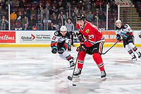 KELOWNA, BC - FEBRUARY 7: Dillon Hamaliuk #22 of the Kelowna Rockets stick checks Jonas Brøndberg #27 of the Portland Winterhawks as he skates over centre ice with the puck in second period at Prospera Place on February 7, 2020 in Kelowna, Canada. (Photo by Marissa Baecker/Shoot the Breeze)
