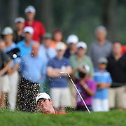 Rory McIlroy plays out of the sand trap on the 12th hole during the first round of theThe Barclays Golf Tournament at The Ridgewood Country Club, Paramus, New Jersey, USA. 21st August 2014. Photo Tim Clayton