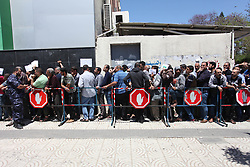 May 13, 2019 - Gaza City, Gaza Strip, Palestinian Territory - Palestinians wait to receive their financial aid outside the Post Office, in Gaza city. The Qatar grant on Monday began disbursing $100 to Poor Families  (Credit Image: © Mahmoud Ajjour/APA Images via ZUMA Wire)