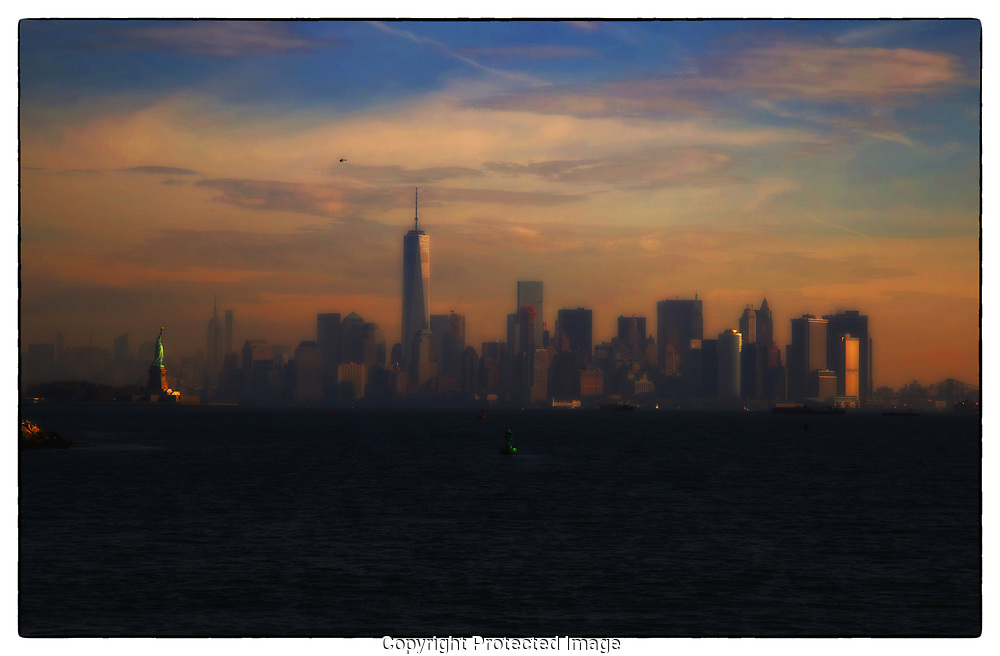 As a photographer I am an advocate of using natural light. The easy morning sunlight paints a dramatic backdrop to the Lower Manhattan Skyline and spotlights the Statue of Liberty.
