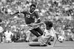 New York Cosmos' Pele (10) is taken down during the match