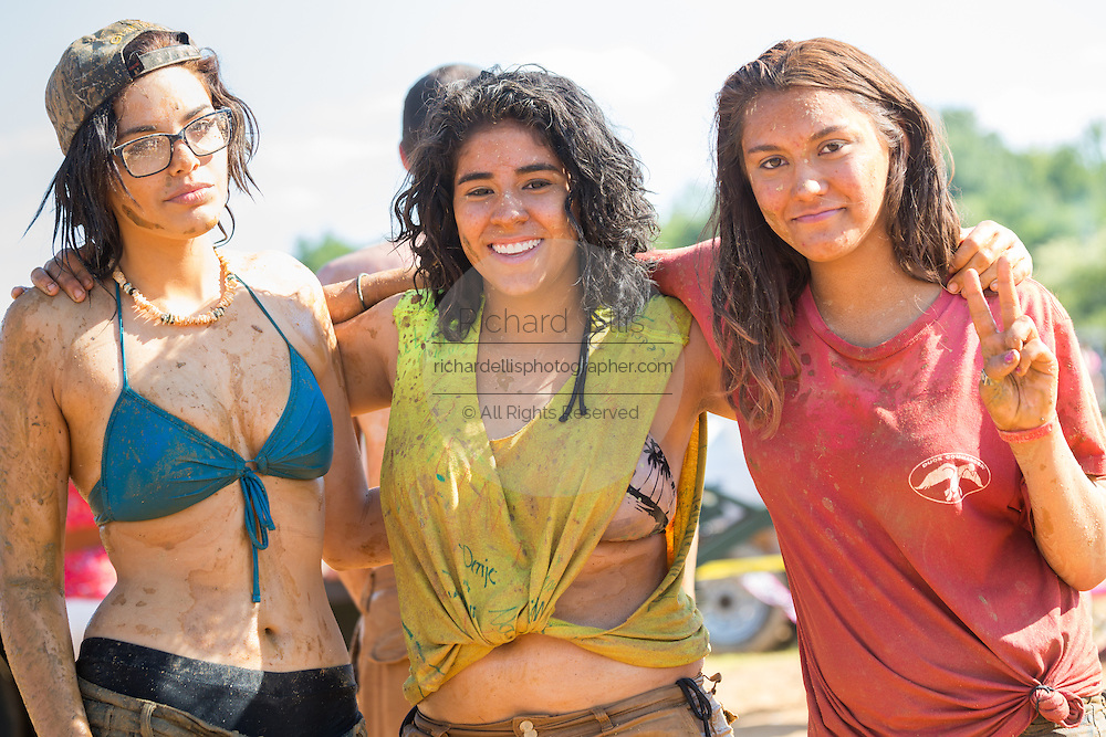 A group of young women covered in mud at the 2015 National Red Neck Championships May 2, 2015 in Augusta, Georgia. Hundreds of people joined in a day of country sport and activities.