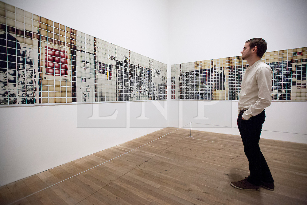 © Licensed to London News Pictures. 08/10/2012. LONDON, UK. A member of Tate staff looks at Daido Moriyama's 'Polaroid/Polaroid' (1997), a mosaic of the artist's studio made up of single polaroid photographs, at an exhibition at the Tate Modern in London today (08/10/12). The exhibition, entitled 'William Klein + Dado Moriyama', is the first to examine the relationship between the work of photographer/film maker William Klein (b. 1928) and photographer Dado Moriyama (b. 1938) and opens to the public on the 10th of October 2012.  Photo credit: Matt Cetti-Roberts/LNP