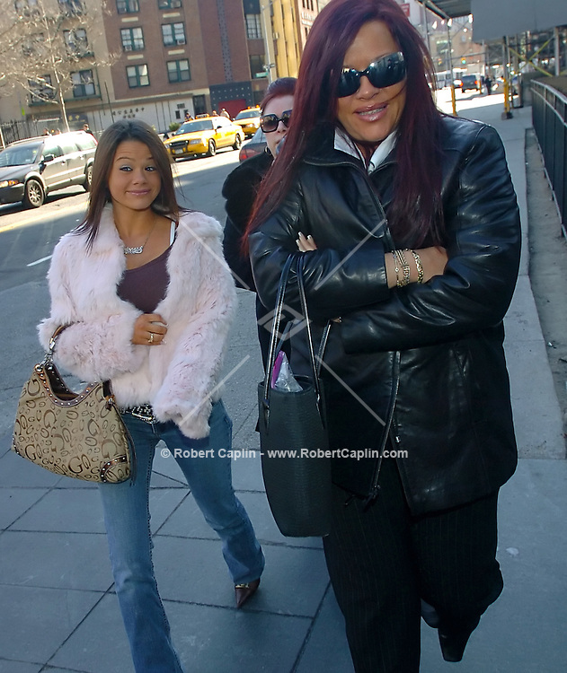 Victoria Gotti, background, mother of John Gotti Jr., Angel Gotti, right, sister, and unconfirmed/unidentified family member, left, walk into court for the trial of John Gotti Jr at 500 Pearl Street in Manhattan Wed. March 1, 2006.