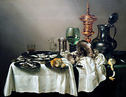 Still Life with a Gilt Cup by Willem Claesz Heda (1594-1680) oil on panel, 1635  The range of grey tonalities that Willem Heda could paint is astounding.  With this subtle palette, he deftly rendered the objects - of pewter, silver, damask, glass and mother-of-pearl - on this table.  A few yellow and ochre accents compliment this refined interplay of colours.  Heda specialized in near monochromatic still lives, so called 'tonal banquet pieces'.