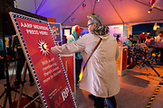 Attendee Renata Moon pushes the member button at the AARP Block Party at the Albuquerque International Balloon Fiesta in Albuquerque New Mexico USA on Oct. 8th, 2018.