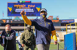 Oct 31, 2020; Morgantown, West Virginia, USA; West Virginia Mountaineers head coach Neal Brown celebrates after defeating the Kansas State Wildcats at Mountaineer Field at Milan Puskar Stadium. Mandatory Credit: Ben Queen-USA TODAY Sports