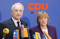 17 JAN 2002, BERLIN/GERMANY:<br /> Edmund Stoiber, CSU, Ministerpraesident Bayern und CDU/CSU Spitzenkandidat, und Angela Merkel, CDU Bundesvorsitzende, waehrend einem Pressestatement zu einer vorangegangenen Besprechung ueber die Organisation des Bundestagswahlkampfes, CDU Bundesgeschaeftsstelle<br /> IMAGE: 20020117-01-009<br /> KEYWORDS: Ministerpräsident, Mikrofon, microphone, Pressekonferenz