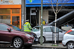 © Licensed to London News Pictures. 28/03/2018. LONDON, UK.  A silver Jaguar car has crashed into a pharmacy in Golders Green, north London following a road traffic accident.  It is reported that two people were taken to hospital with injuries.  Golders Green Road is currently cordoned off while police attend the scene.  Photo credit: Stephen Chung/LNP