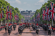 """Trooping the Colour by the Irish Guards on the Queen's Birthday Parade. The Queen's Colour is """"Trooped"""" in front of Her Majesty The Queen and all the Royal Colonels.  His Royal Highness The Duke of Cambridge takes the Colonel's Review for the first time on Horse Guards Parade riding his horse Wellesley. The Irish Guards are led out by their famous wolfhound mascot Domhnall and more than one thousand Household Division soldiers perform their ceremonial duty. The Soldiers will parade in the traditional ceremonial uniforms of the Household Cavalry, Royal Horse Artillery, and Foot Guards. They are accompanied by the Household Division Bands & Corps of Drums. London 17th June 2017."""