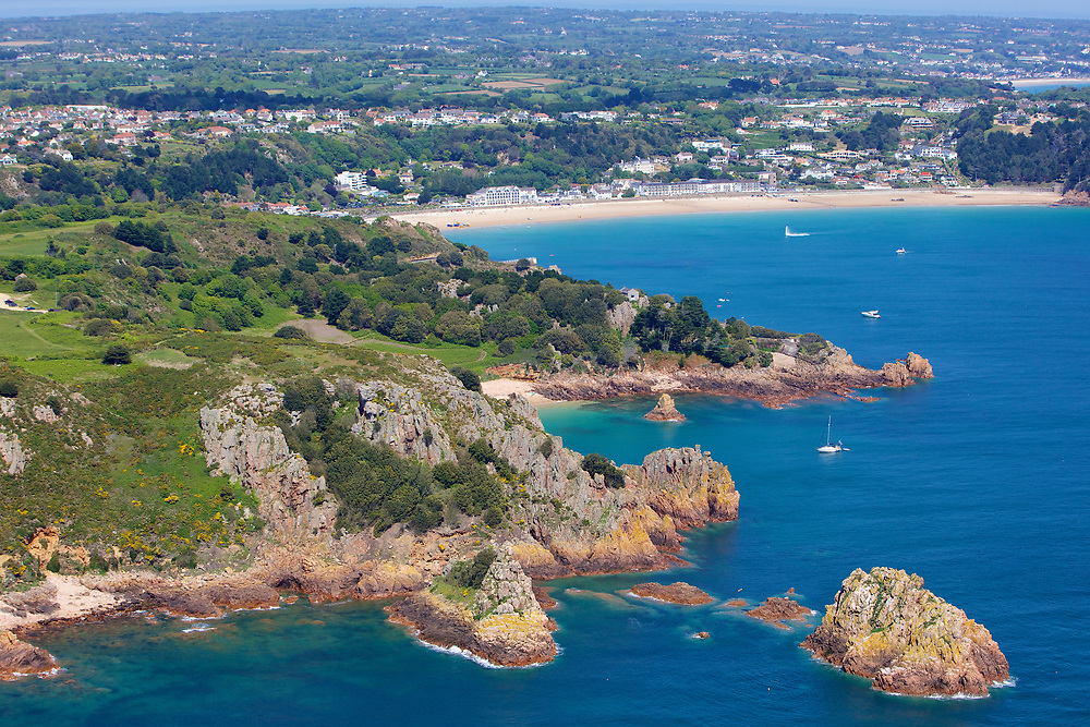 Aerial view of the coastline in St Brelade on a calm sunny day in Jersey, Channel Islands