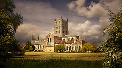 Tewkesbury Abbey seen from across the river meadows in Gloucestershire, UK