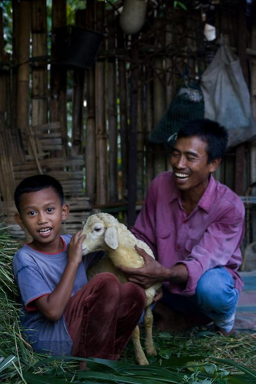 Kota Pari Village near Medan - North Sumatra, Indonesia  Nov. 2008. (Heifer Participant)  A portrait of Aldi Setiyawan (left) with his father Ahmad Supend (right), and their lamb.