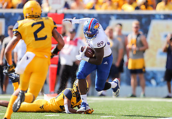 Oct 6, 2018; Morgantown, WV, USA; Kansas Jayhawks tight end Mavin Saunders (89) catches a pass for a touchdown during the first quarter against the West Virginia Mountaineers at Mountaineer Field at Milan Puskar Stadium. Mandatory Credit: Ben Queen-USA TODAY Sports