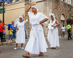 Kathleen Pascal, Marie Paul, and Marcella portray the striking coal workers.  10th Annual Dollar Fo' Dollar Culture & History Tour commemorating the anniversary of the successful protest  demanding better pay by Queen Coziah and the 19th century coal laborers in the streets of downtown Charlotte Amalie.  12 September 2015.  St. Thomas, VI.  © Aisha-Zakiya Boyd