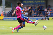 AFC Wimbledon striker Andy Barcham (17) battles for possession with Queens Park Rangers defender Darnell Furlong (2) during the Pre-Season Friendly match between AFC Wimbledon and Queens Park Rangers at the Cherry Red Records Stadium, Kingston, England on 14 July 2018. Picture by Matthew Redman.