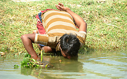 April 26, 2017 - Allahabad, Uttar Pradesh, India - Allahabad: A youth drink water from a Canal during a hot day at Shankargarh area in allahabad on 26-04-2017, During Summer approx all well and handpump are parshed. photo by prabhat kumar verma (Credit Image: © Prabhat Kumar Verma via ZUMA Wire)