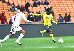 South Africa: Johannesburg: Bafana Bafana player Percy Tau takes a shot during Seychelles player Jones Joburt for the Africa Cup Of Nations qualifiers at FNB stadium, Gauteng.<br />Picture: Itumeleng English/African News Agency (ANA)