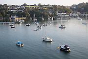 Yachts at moorings on River Fal, Flushing, Cornwall, England, UK