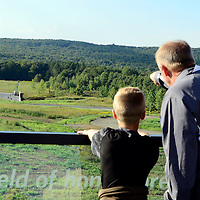 Visitors walk to the end of the overlook at the Flight 93 National Memorial to view the crash site on the 14th Observance  of Flight 93 Crash and Terrorist Attacks on America near Shanksville, Pennsylvania on September 11, 2015.  Photo by Archie Carpenter/UPI